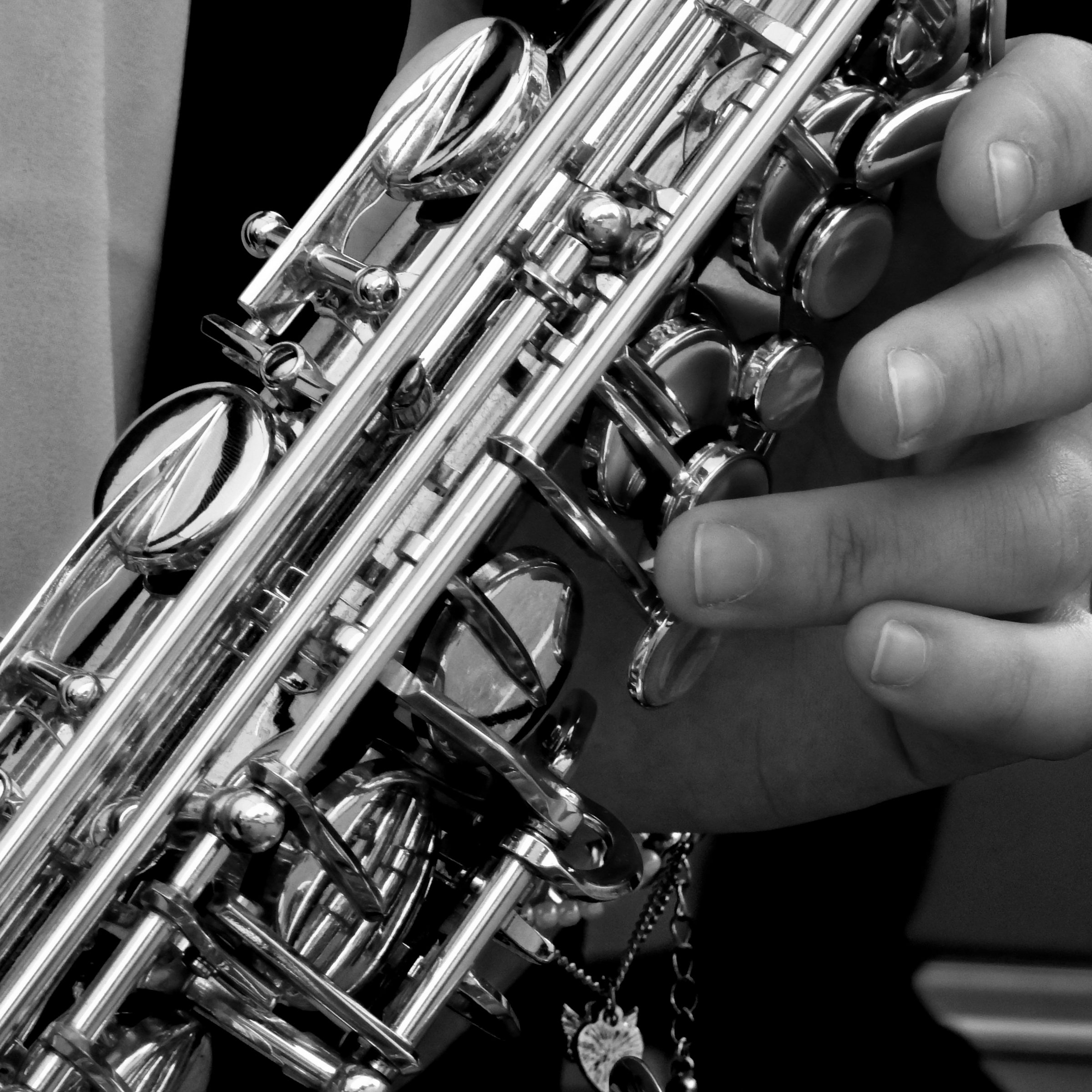 a close up of a hand playing on a saxophone