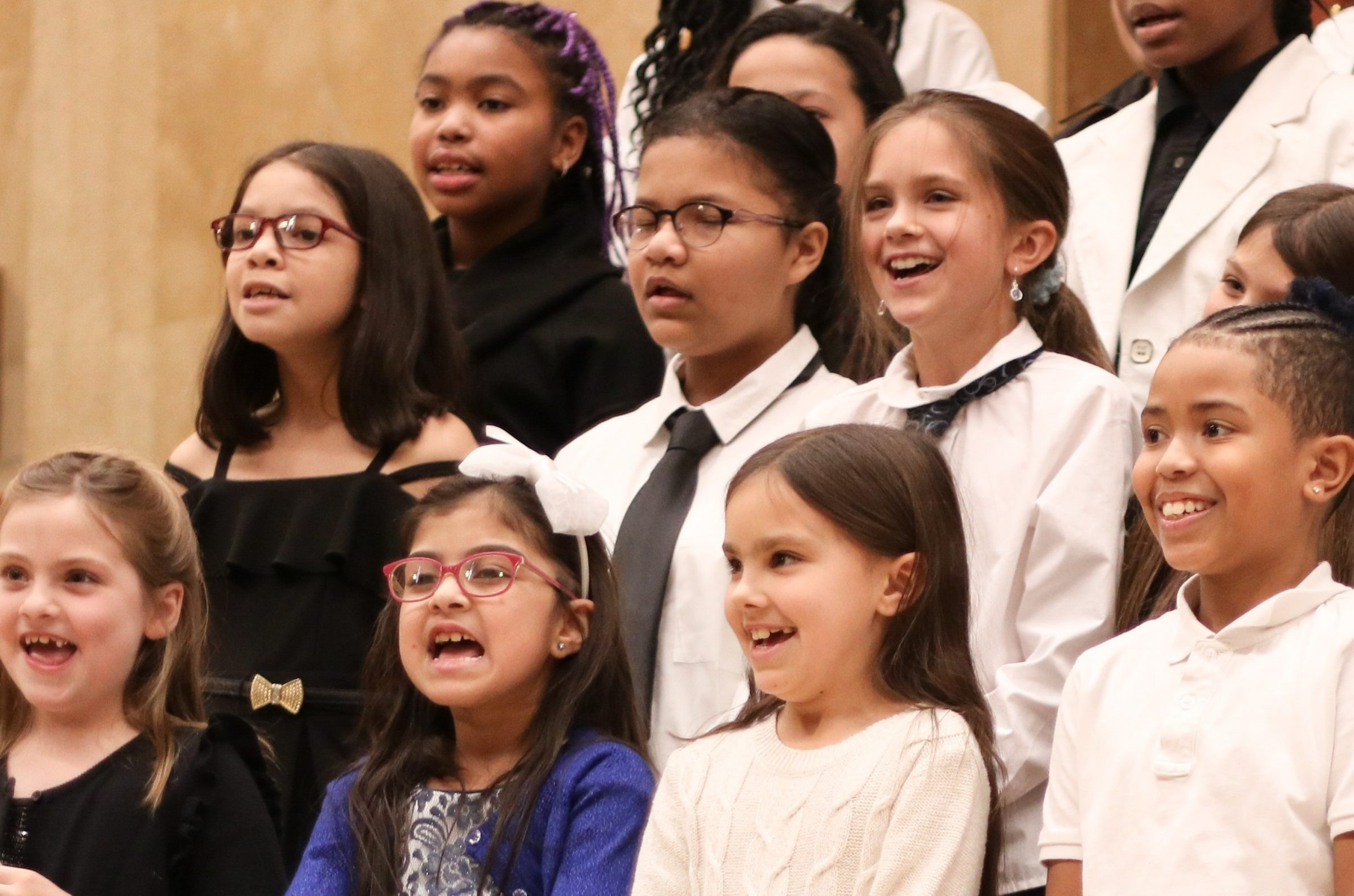 Close up of a portion of Children's Chorus members singing in their winter concert