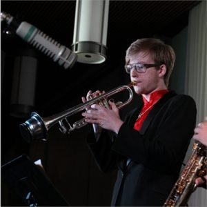 photo of justin playing trumpet in a recording studio